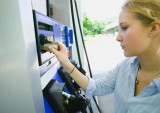 Teenage Girl Using Credit Card at Gas Station
