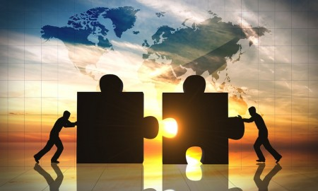World Business teamwork puzzle pieces