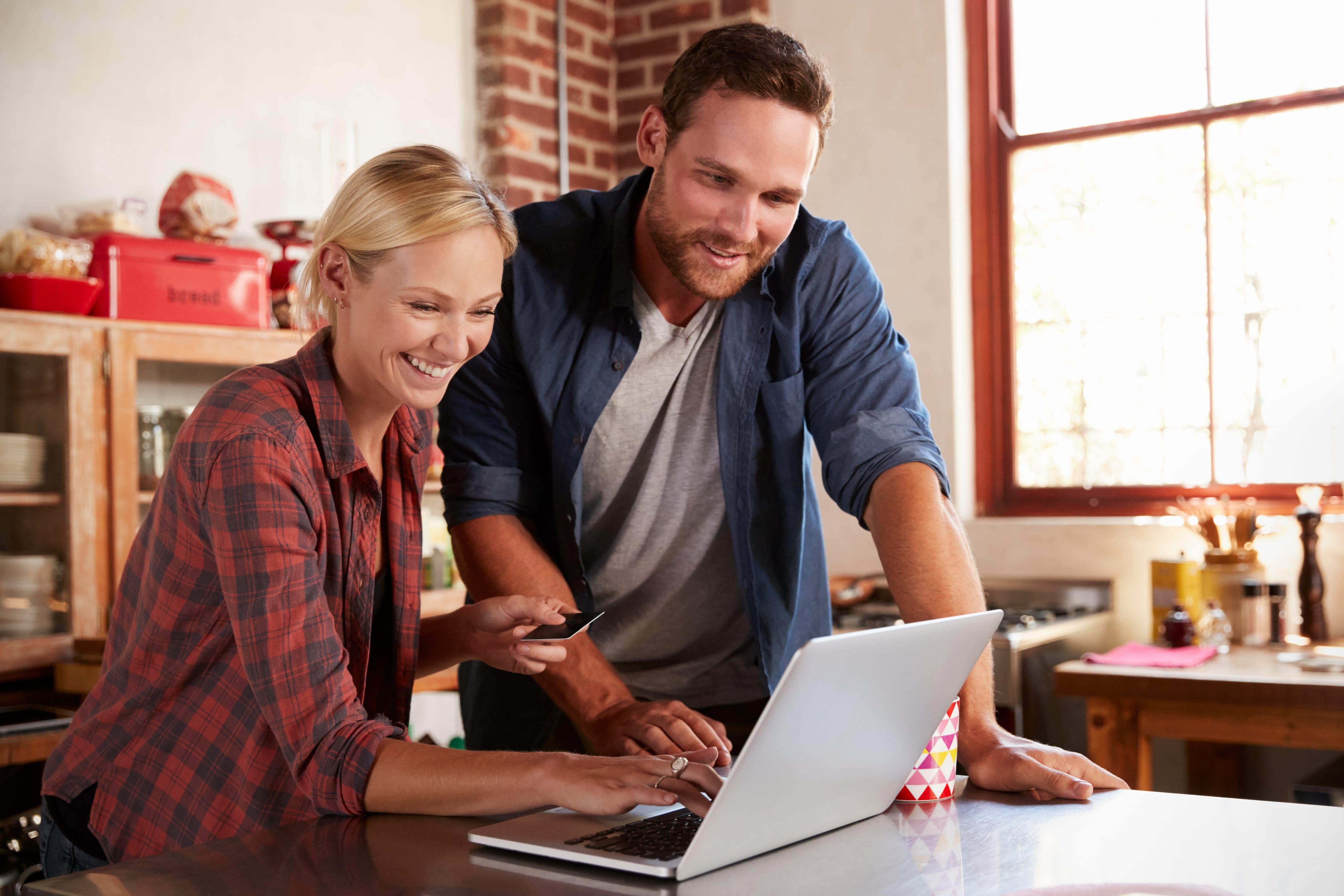 millennial couple online shopping